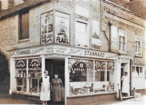 18029001Stannard's Shop 1920Charlotte and son Charles Stannard & shop assistant