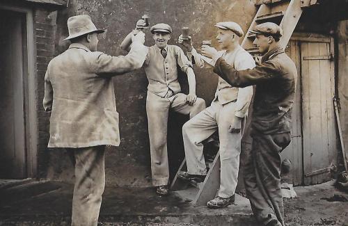 p97.14 men drinking beer at Denver Mill